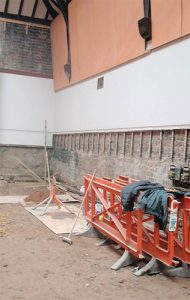 Area 2 - Excavated floor level, with panelling removed for damp proofing works
