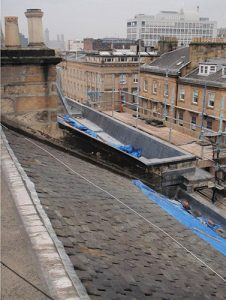 Area 3 - View of slating to east roof, to be removed and set aside for re-use. Note complete leadwork to west parapet gutter