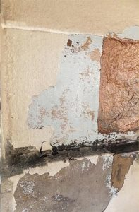 Area 4 - View of trial area showing layers of paint: silicate type paint, on grey gloss paint on eroded stonework