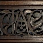 Fretwork cover of ventilation duct incorporating the letters G, A and C